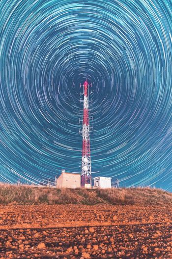 Scenic view of tower against sky at night