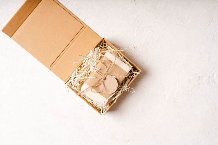 High angle view of paper box on white wall