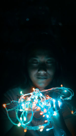 Portrait of girl with illuminated light painting
