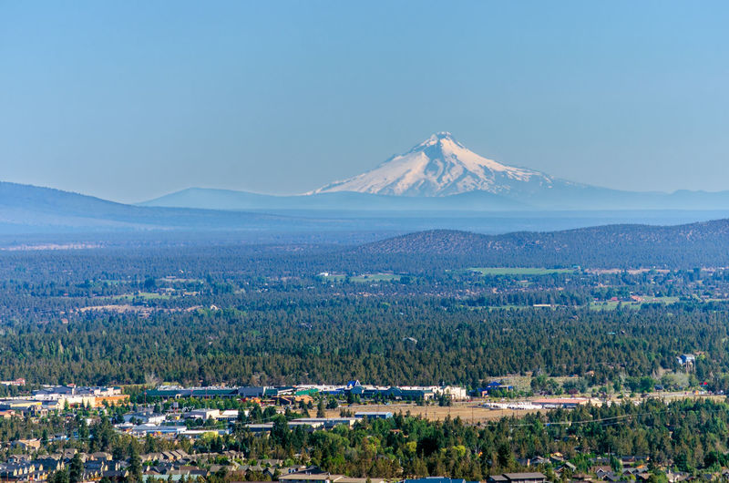 Scenic view of landscape with mt hood in background against clear sky