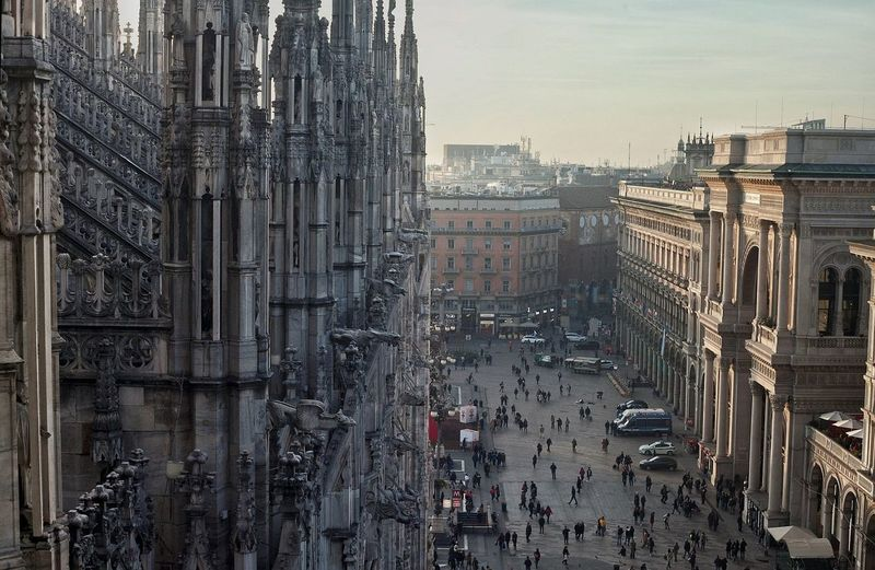 People On Street By Duomo Di Milano Against Sky