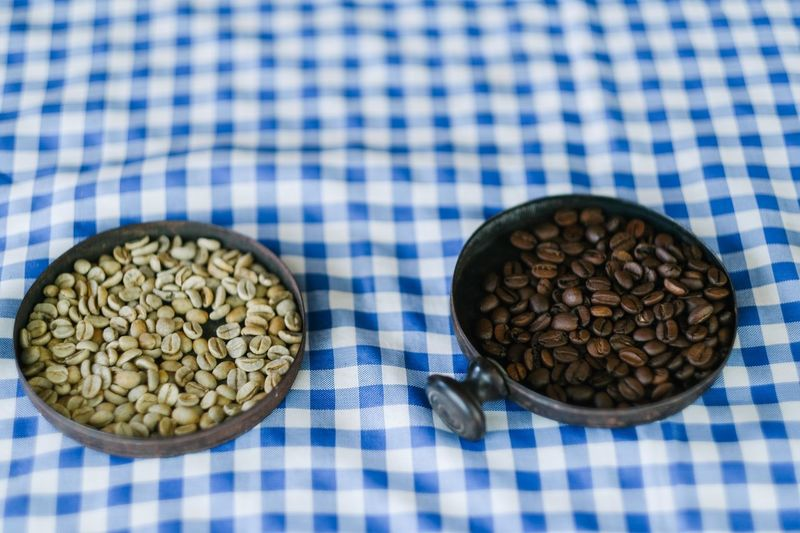 Coffee beans before and after being roasted Coffee Coffee ☕ Coffee Bean Brazilian Coffee Coffee Farm Coffee Beans Coffee Plantations Coffee Plant Food And Drink Food Indoors  Freshness No People Healthy Eating Wellbeing Tablecloth Blue Checked Pattern Still Life High Angle View Close-up Textile Dish Towel