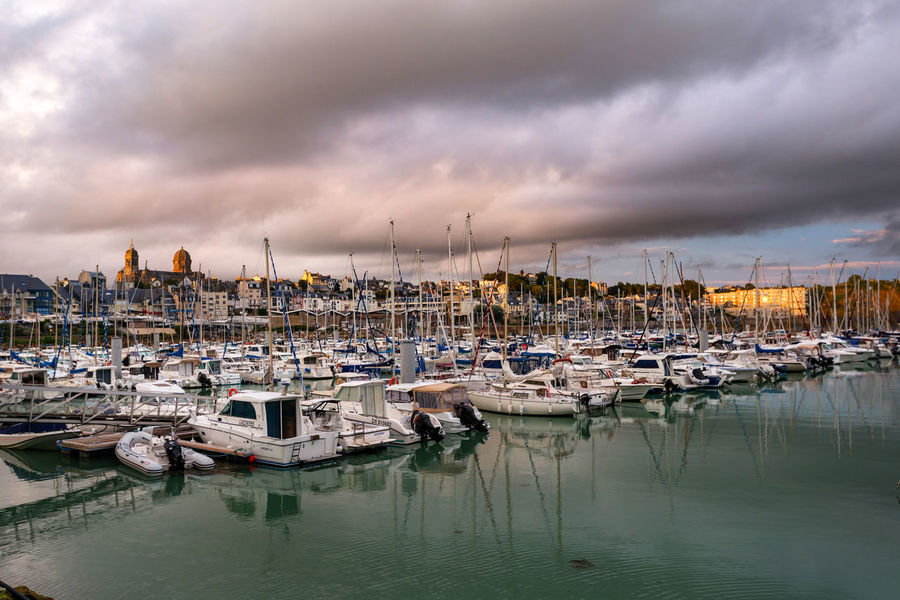 Clouds And Sky Harbor Mast Mode Of Transport Moored Nature Nautical Vessel No People Outdoors Sailboat Sea Sky Transportation Water