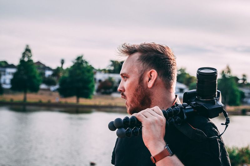 Vlogger vlogging on the job Photography Tripod Joby Tripod Joby Action Tripod JOBYPhotography Tripods DSLR Vlogging Vlogging One Person Photography Themes Technology Activity Water Real People Photographing Photographic Equipment Photographer Lifestyles Digital Camera Men Portrait Nature
