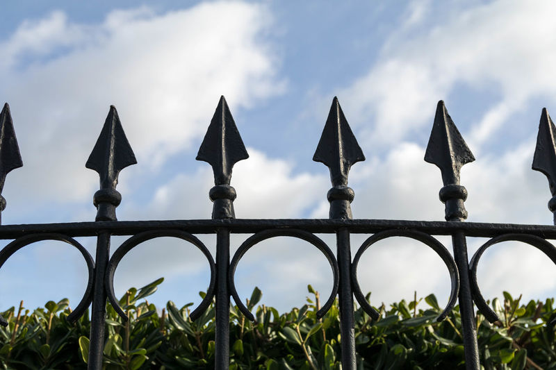 EyeEm Best Shots EyeEm Eye4photography  EyeEm Best Pics Architecture Outdoors Close-up Low Angle View Sky Cloud - Sky Security Protection Safety Metal Fence Boundary Barrier Sharp Focus On Foreground Plant