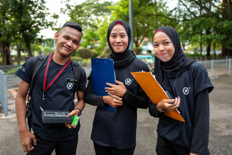 Malacca Young Adult Smiling Standing Looking At Camera Three Quarter Length Portrait Young Women Front View Group Of People Happiness Young Men Togetherness Emotion Men Learning Day University Communication Outdoors