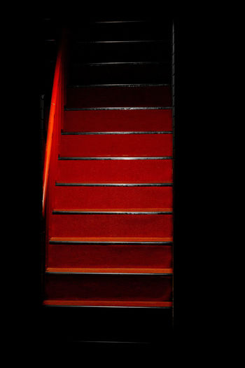 Close-up of red staircase in building