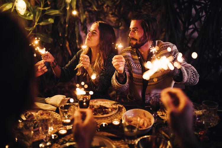 People on illuminated christmas decorations