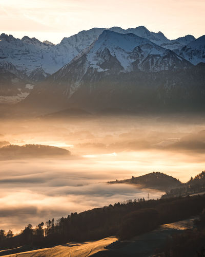 Mountain Scenics - Nature Sunset Beauty In Nature Tranquil Scene Mountain Range Sky Environment Tranquility Non-urban Scene Idyllic Landscape Winter Cold Temperature Nature Snow Orange Color Cloud - Sky No People Snowcapped Mountain Outdoors Mountain Peak Fog Morning Gantrisch