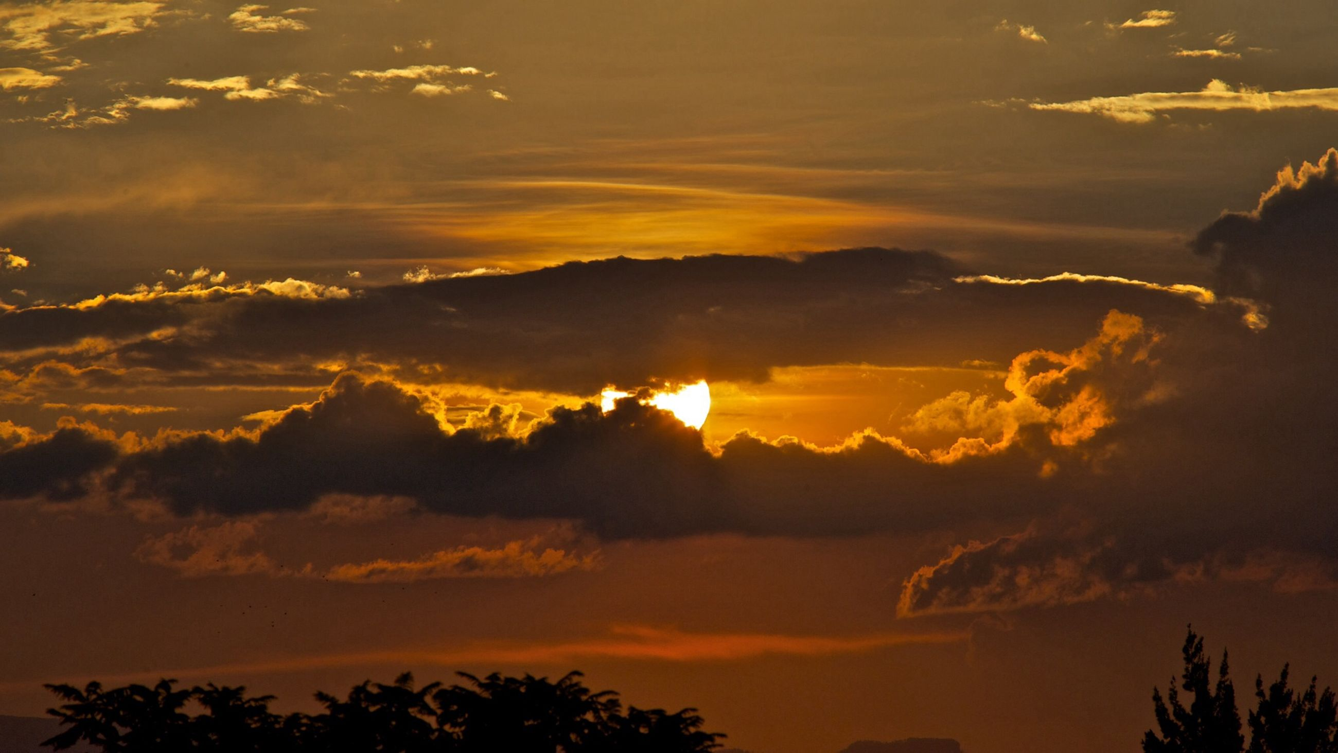 sunset, scenics, beauty in nature, sky, tranquil scene, orange color, tranquility, silhouette, cloud - sky, idyllic, nature, dramatic sky, sun, majestic, cloud, atmospheric mood, tree, awe, atmosphere, outdoors
