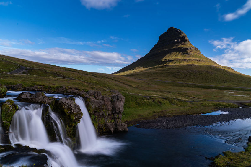Kirkjufell Backgrounds Beautifuliceland Beauty In Nature Cloud - Sky Day Environment Flowing Flowing Water Idyllic Land Landscape Long Exposure Motion Mountain Mountain Peak Nature No People Non-urban Scene Outdoors Rock Scenics - Nature Sky Tranquil Scene Tranquility Water