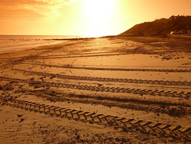 Beach Beauty In Nature Sand Scenics Sea Shore Sun Sunlight Sunrise Sunrise_sunsets_aroundworld Sunrise_Collection Tractor Tracks Tracks Tranquil Scene Tranquility