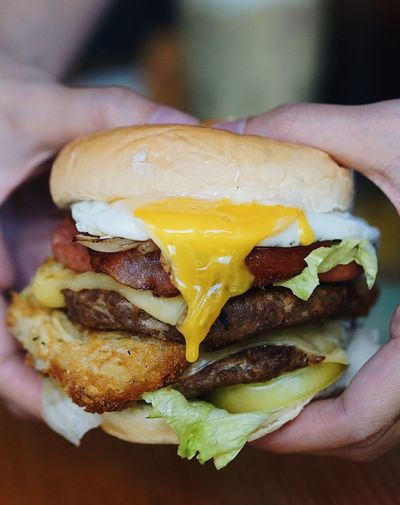 Burger Human Hand Human Body Part Real People Food And Drink One Person Human Finger Holding Food Burger Unhealthy Eating Hamburger Unrecognizable Person Indoors  Ready-to-eat Close-up Focus On Foreground Fried Egg Freshness Men Take Out Food