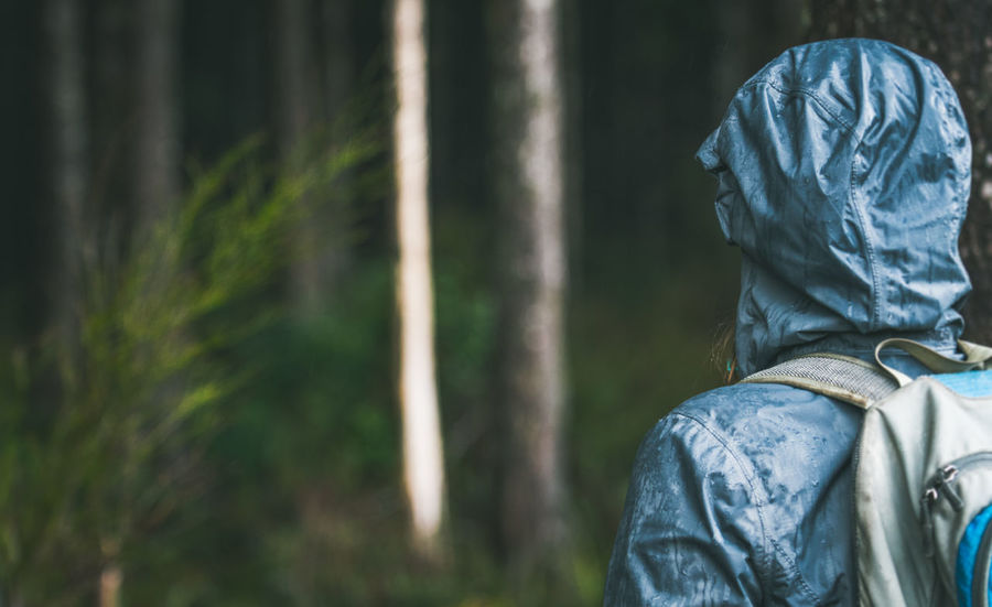 Hooded hiker in dark forest Adult Adults Only Adventure Backpack Close-up Day Forest Hiking Hood - Clothing Nature One Person Outdoors People Rain Rain Gear Real People Rule Of Thirds Tree Warm Clothing Weather Woman Young Adult
