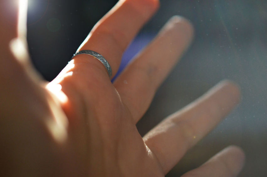 Light on a hand Light Beam Close-up Dust Human Body Part Human Hand Indoors  Low Section Ring