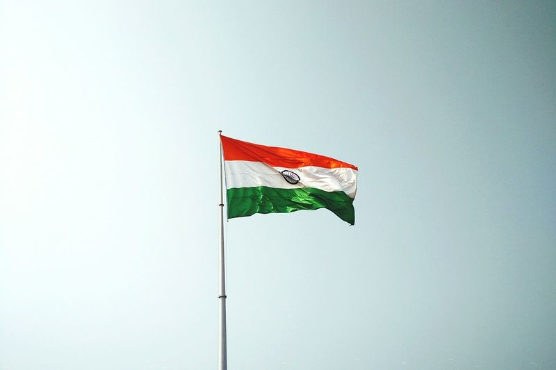 Waving India Flag over clear sky background. India Indian India Flag Indian Flag Waving Flag Floating Flying Flag Pole National Flag Asian Country Background Country Flag Flags In The Wind  Democracy Emblem  National Anthem Nation Patriotic Patriotism Pride Ripple Sky Orange White Green <3 Wave