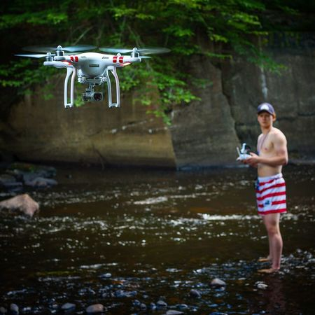 Mid-air Flying One Person Day Holding Standing Outdoors Full Length Water People Adult One Man Only Adults Only Drone  Quadcopter