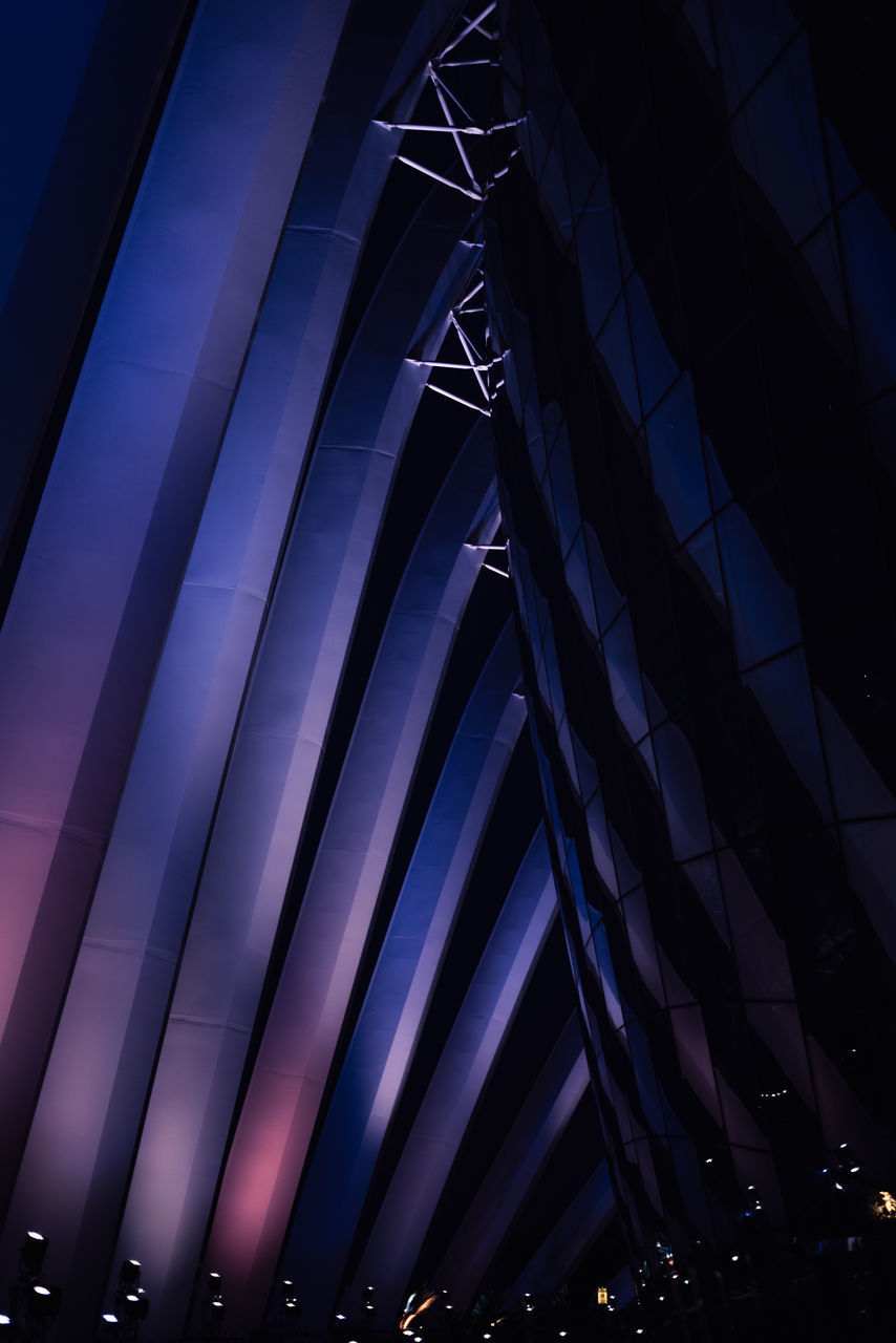 night, low angle view, illuminated, architecture, built structure, pattern, no people, lighting equipment, indoors, arts culture and entertainment, modern, city, dusk, blue, nightlife, light, glowing, design, metal, ceiling