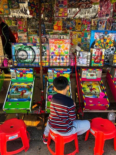Let's play. Win Prizes Funfare Games Playing Rear View Multi Colored Variation Real People One Person Childhood