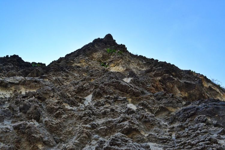 Break The Mold Mountain Rock - Object Mountain Peak Sky Outdoors Low Angle View Landscape Travel Destinations Nature Day Clear Sky Scenics Beauty In Nature Climbing Rock Face EyeEm Best Shots Blue Sky Perspective Tranquil Scene