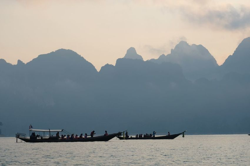 Mountain and the boats Nautical Vessel Transportation Water Mode Of Transportation Sea Sky Scenics - Nature Outdoors Group Of People Tranquility Tranquil Scene Mountain Range Travel Incidental People Nature Beauty In Nature Mountain People Men