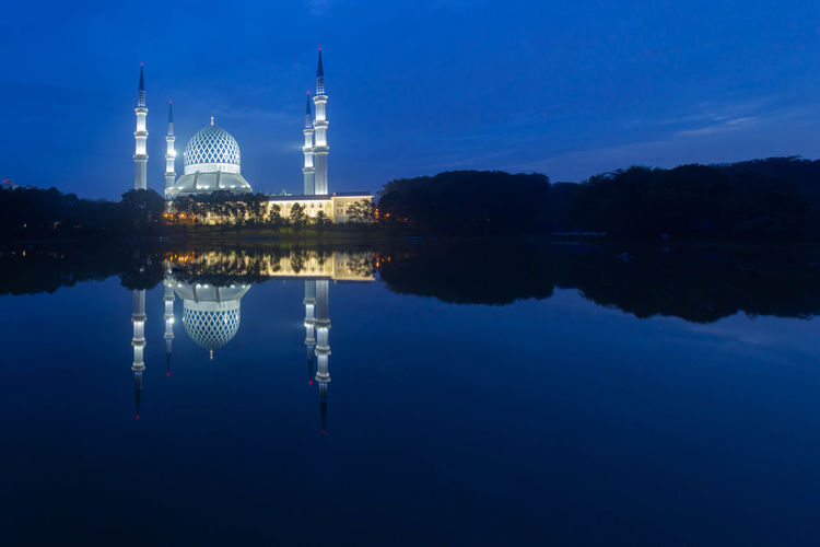 Reflection Architecture Water Built Structure Sky Building Exterior Religion Belief Spirituality Lake Place Of Worship Blue Waterfront Travel Destinations No People Travel Nature Spire