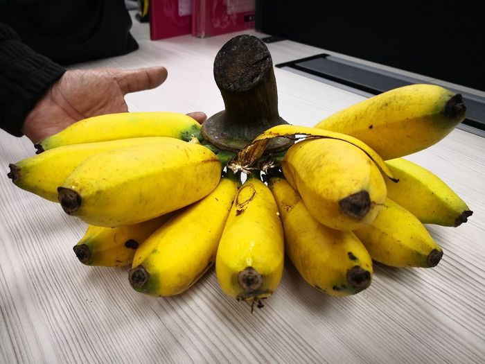 Super big banana. Yellow One Person Fruit Banana Human Hand One Man Only Human Body Part Freshness Healthy Eating