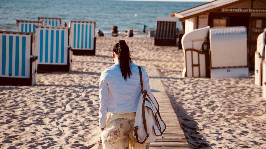 Rear View Of Woman Walking At Beach