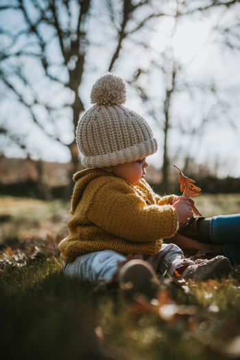 Blooming Yellow Family Matters Family With One Child Togetherness Daughter Winter Real People Lifestyles Warm Clothing Clothing Knit Hat Leisure Activity Childhood Land Hat Outdoors Day Nature Babyhood Child Inocence  Positive Emotion Enjoying Life Selective Focus