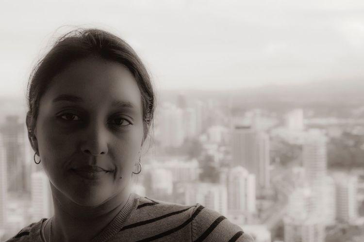 Portrait Of Woman Against Cityscape