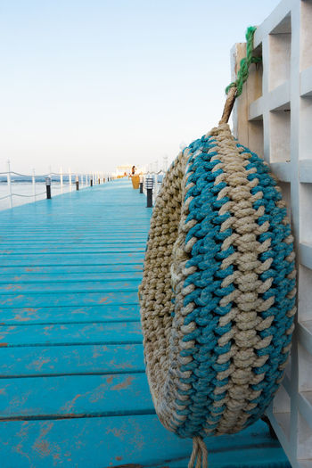 RIXOS SHARM EL SHEIK, EGYPT - AUGUST 25, 2015: Pier into the blue sea with traditional fender Blackandwhite Blue Blue Sky Clear Sky Garden Great Views Green Color Growth Hotel Rixos Landscape Love M No People Outdoors Palm Tree Relaxing S Sea Sharm El Sheik Sky Summer Tranquility Travel Destinations Vacations Water