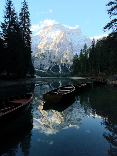 Beauty In Nature Day Lake Mode Of Transportation Moored Mountain Nature Nautical Vessel No People Outdoors Plant Reflection Rowboat Scenics - Nature Sky Snowcapped Mountain Tranquil Scene Tranquility Transportation Tree Water
