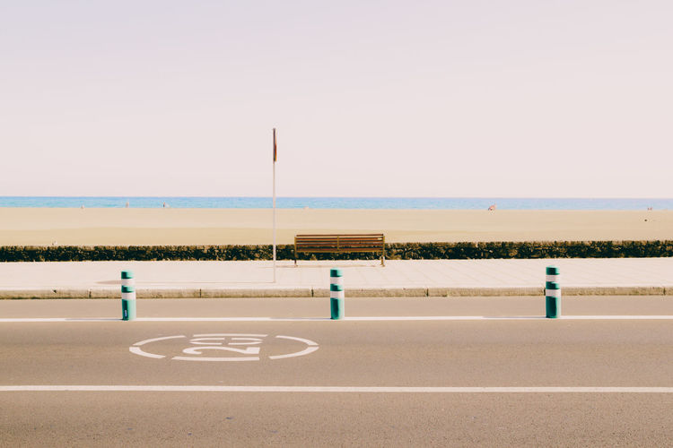 At the Beach Clear Sky Color Filter Copy Space Empty Guidance Horizon Over Water Lanzarote Railing Road Road Marking Road Sign Sea Sign Soft Colors  Softness Street Tourism Tranquility Water