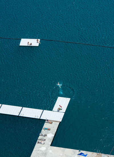 High angle view of floating platforms in sea