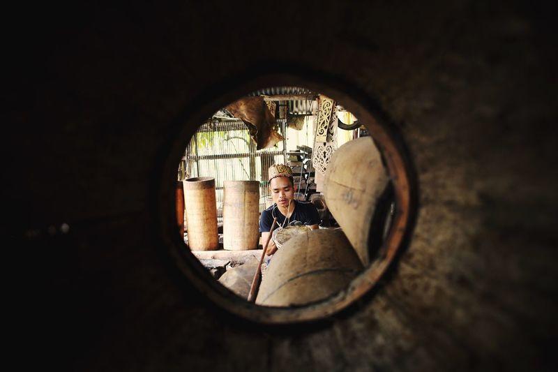 View of man through drum