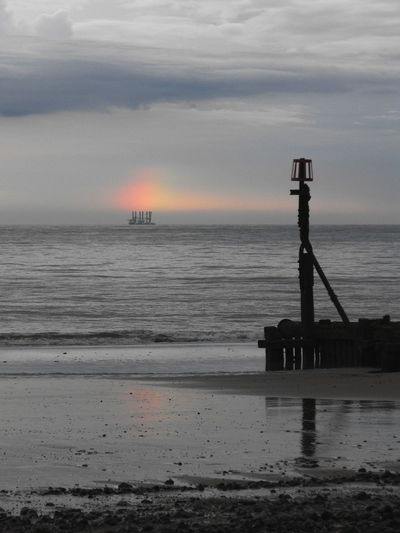 Same place, few years ago, and another unusual sight (a Ship transporting oil rig or wind farm parts at the Rainbows End/under a Mock Sun?) Mundesley Beach Sea North Sea Sky Rainbow Dog Sun Playa Море корабль радуга