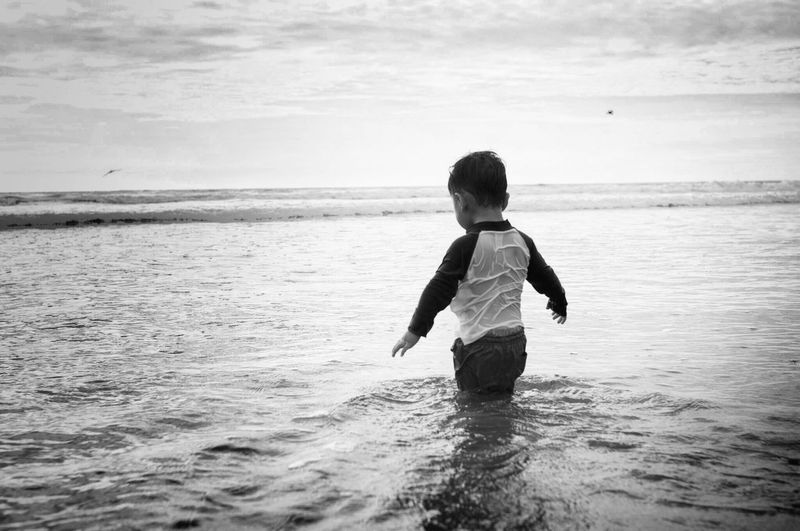 Sea Child Males  Childhood Children Only One Person Water One Boy Only People Beach Wave Outdoors Vacations Horizon Over Water Desaturated Day Welcome To Black TCPM
