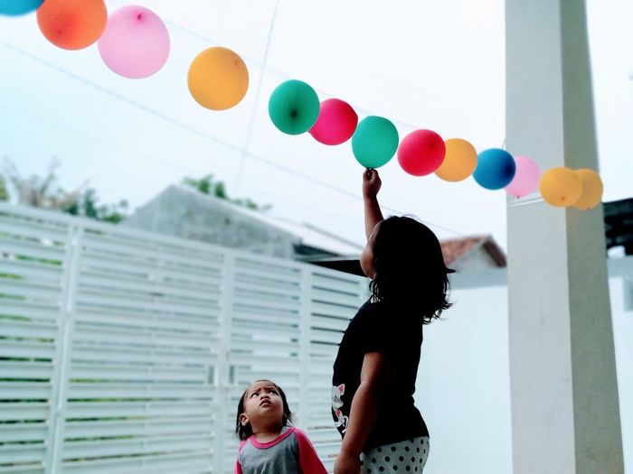 Children and their colorful balloons
