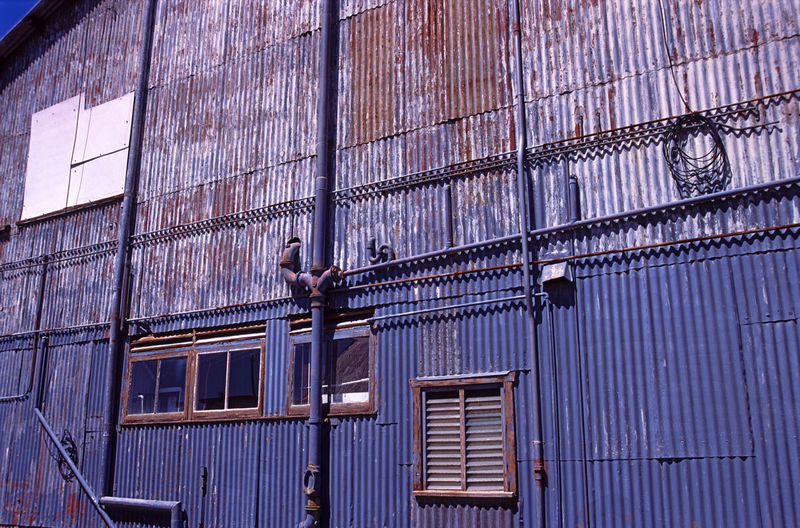 old warehouse facade Abstract Architecture Building Exterior Corrugated Damaged Down Pipe Exterior Metal Cladding Old Painted Pipes Pipework Sheeting Unusual Window Windows