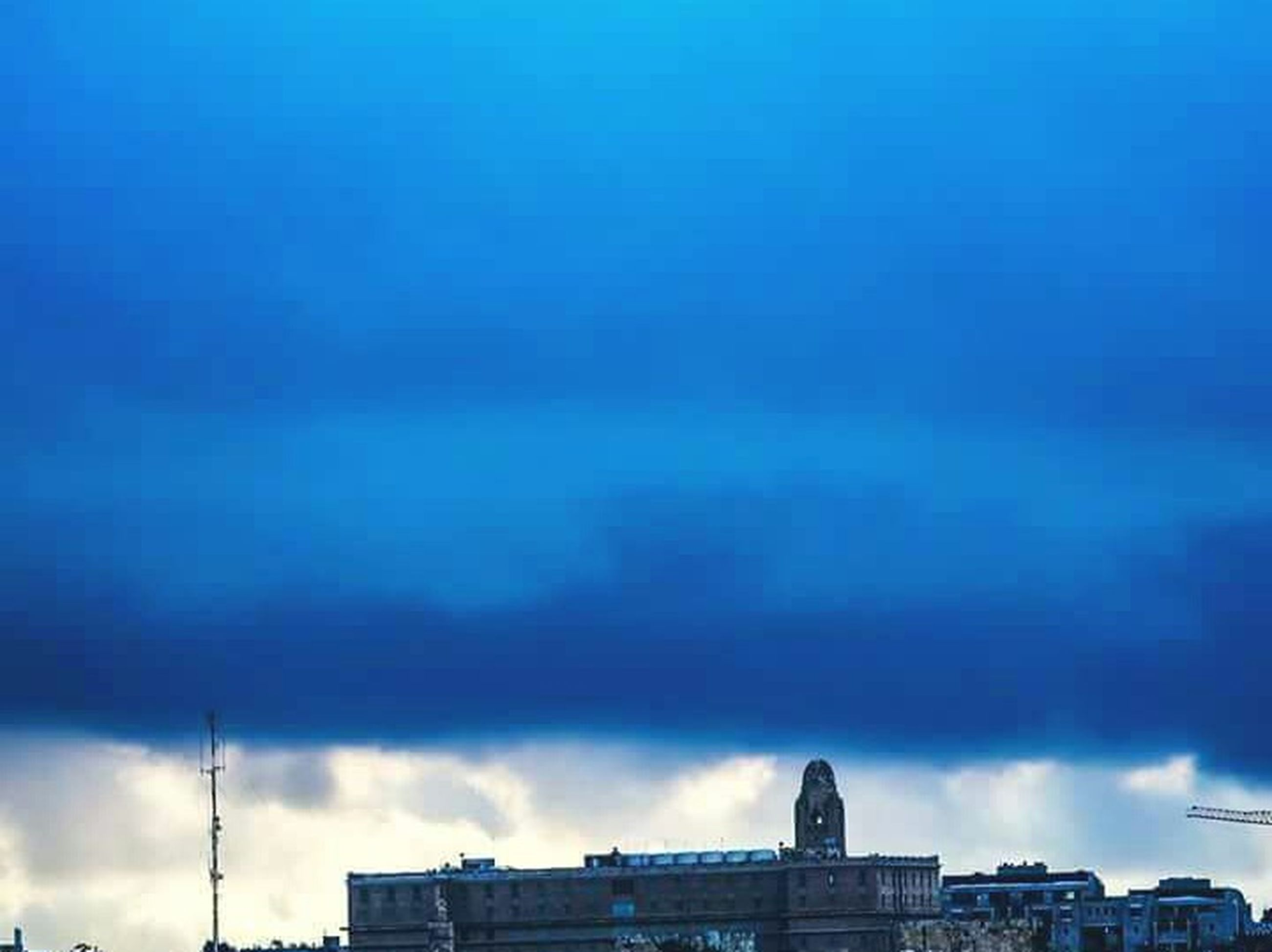 architecture, cloud - sky, built structure, sky, building exterior, blue, outdoors, no people, city, low angle view, cityscape, day, urban skyline