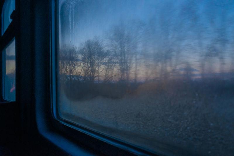Reflection of train on glass window