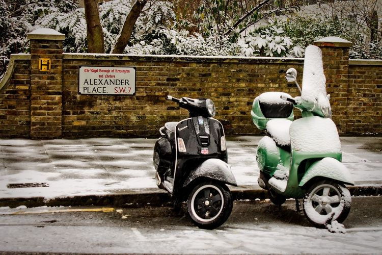 Mopeds in the snow Cool Cold Vintage White Wintertime Winter Snow Moped Vespa Motorcycle Transportation Outdoors Day Architecture