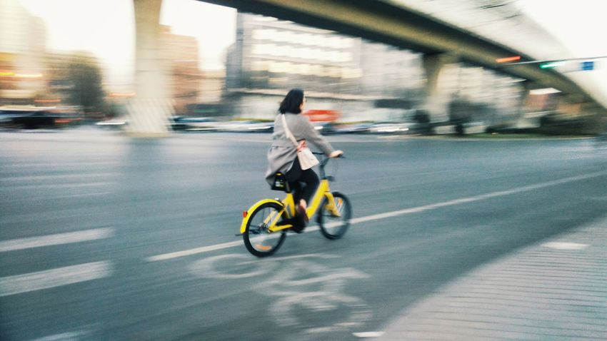 Biking in the ofo. Riding Motion Real People Blurred Motion Transportation Speed One Person Adult Outdoors Bicycle Cycling Ofo Bicycles China
