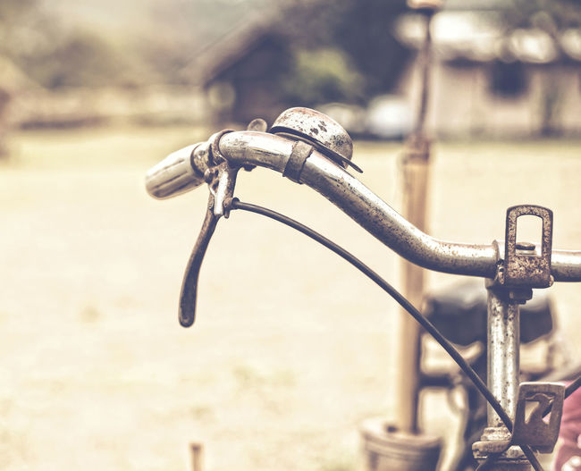 Detail of a Vintage Bicycle Resting in the countryside Street (vintage color toned image) Vintage Bicycle Countryside Rustic Old Old-fashioned Antiques Handlebar