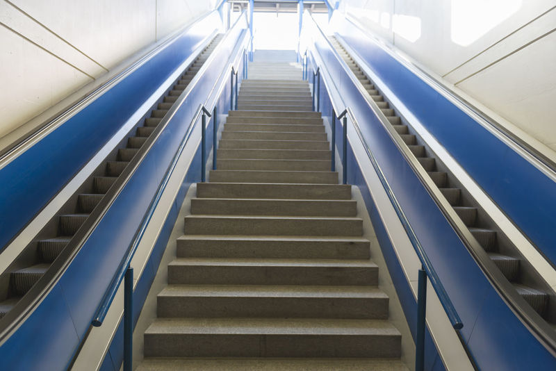 Blue electric escalator and staircase Architecture Blue Color Built Structure Color Day Escalator Escalators Escalators And Staircases Full Frame Hand Rail Indoors  Light Low Angle View Mode Of Transport Modern No People Railing Staircase Steps Steps And Staircases Sunlight Sunny Technology Transportation