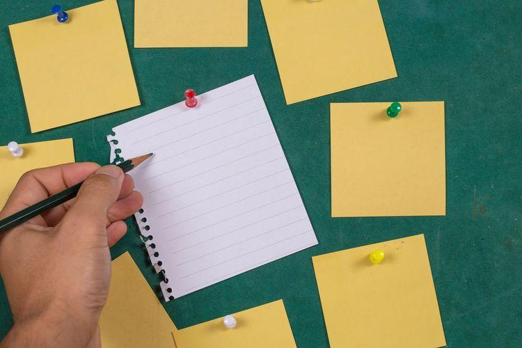 Close-up of blank sticky notes