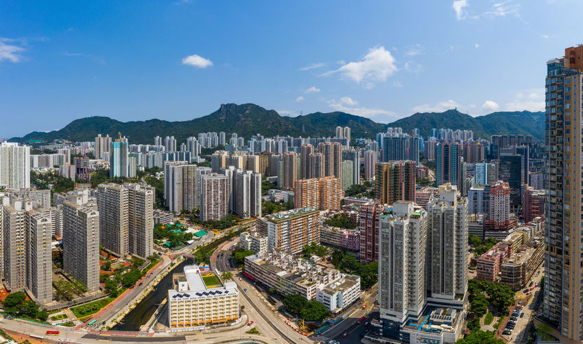 Top view of Hong Kong city Hong Kong Top View City Kowloon Side Lion Rock Mountain Hill Sunny Clear District Cityscape Road Traffic Sky Urban Office Capital Skyline Street Town Aerial Fly Drone  Over Above Down Top Down Bird Eye Hk Hong Kong Downtown Residential  Building Architecture