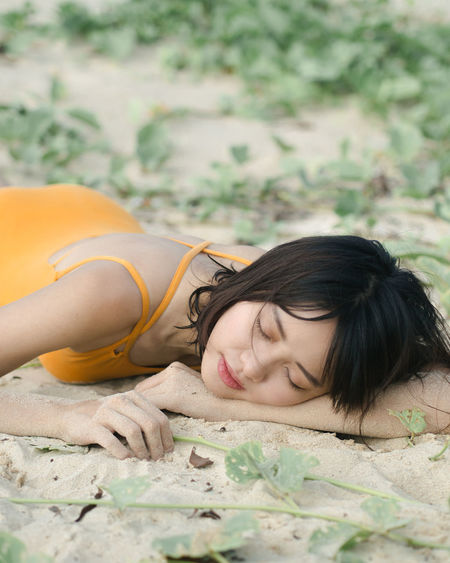 EyeEm Selects Eyes Closed  Lying Down Sleeping People Young Adult Young Women Day Nature Close-up Beauty Women Who Inspire You Portrait Of A Woman Portraits Fashion Photography Sand Outdoors Women Beach Seaside By The Sea Ocean Swimsuit Yellow Portrait Of A Friend Neon Life