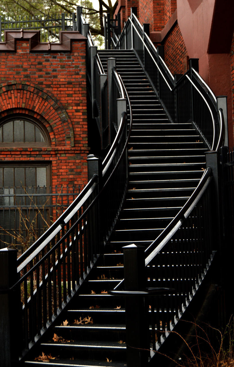 architecture, built structure, staircase, railing, steps and staircases, building, building exterior, day, no people, brick, outdoors, brick wall, metal, empty, direction, arch, pattern, wall, absence