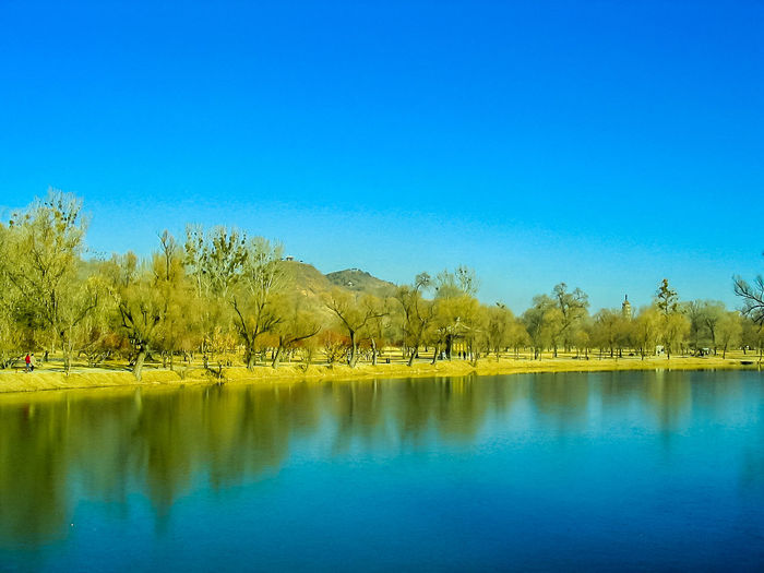 Scenic view at the Mountain Resort in Chengde during autumn Beauty In Nature Blue Clear Sky Day Idyllic Lake Nature No People Outdoors Reflection Scenics Sky Tranquil Scene Tranquility Travel Destinations Tree Water Waterfront